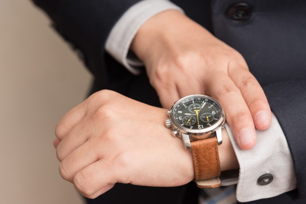 businessman-checking-time_1357-97