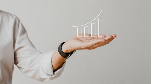 digital-increasing-bar-graph-with-businessman-hand-overlay_53876-97640