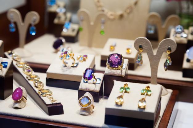 gold-jewelry-with-gems-showcase_1398-4327
